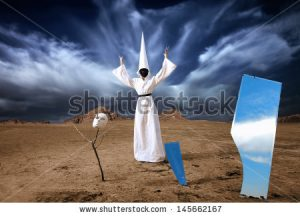 Cloaked figure with all his possessons