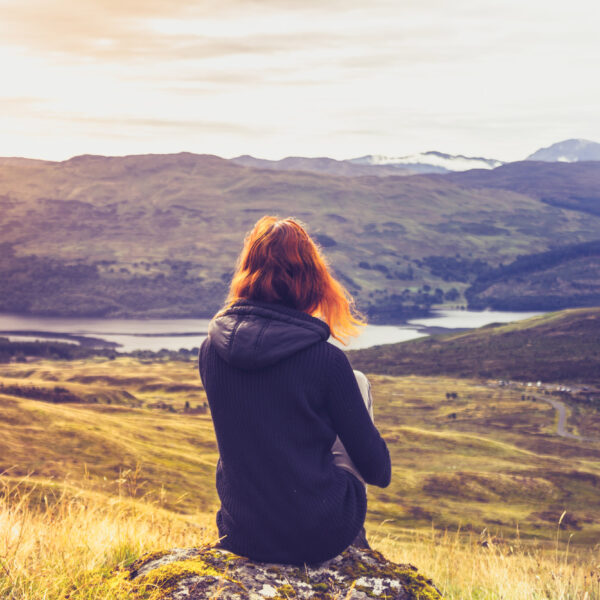 Woman looking at highland skyline