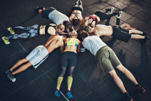 Group of people planking during a workout