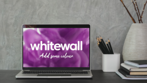 An apple mac with the Whitewall website open on homepage